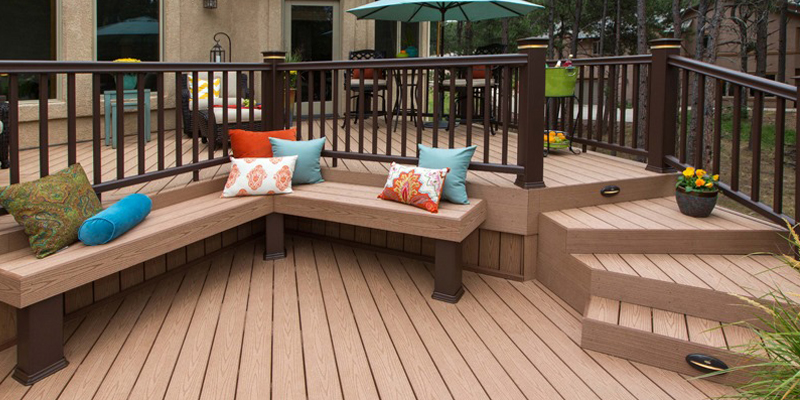 Outdoor space with deck and bench